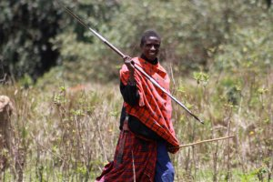 A Masai boy showing how to hold a spear correctly.